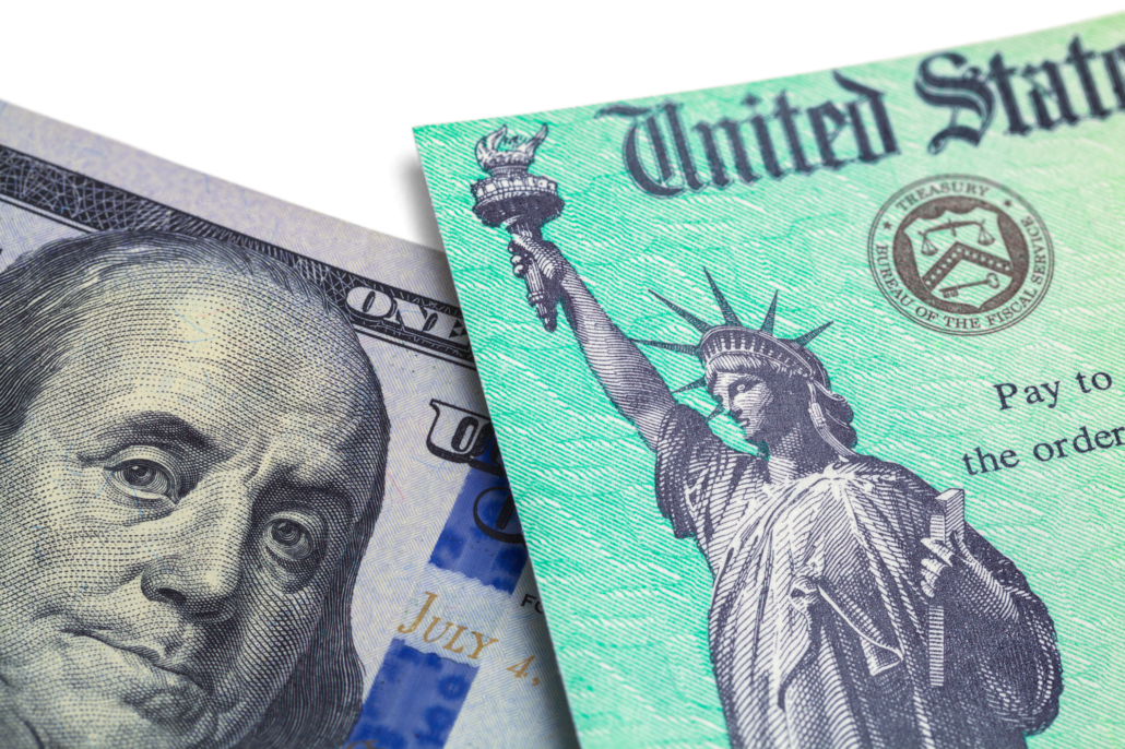 Partial image of 100 dollar bill and corner of stimulus check